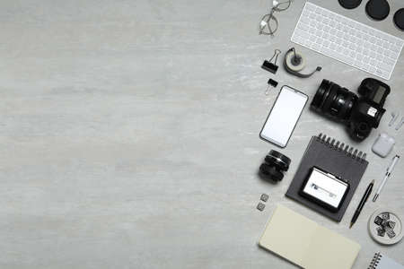 Flat lay composition with equipment for journalist on light table. Space for text