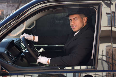 Professional driver in luxury car. Chauffeur service