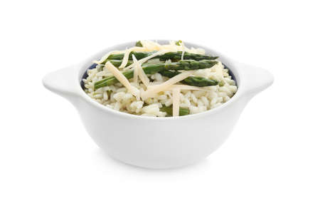 Delicious risotto with asparagus isolated on white