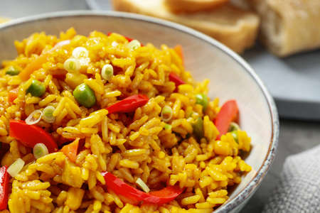 Delicious rice pilaf with vegetables in bowl, closeup Фото со стока