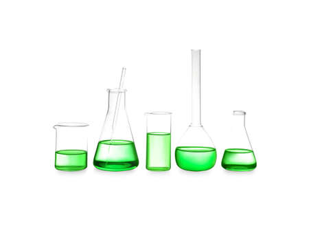 Different laboratory glassware with light green liquid isolated on white