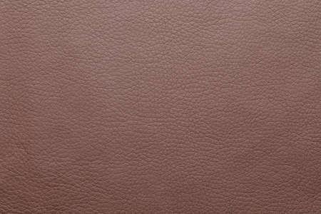 Texture of brown leather as background, closeup