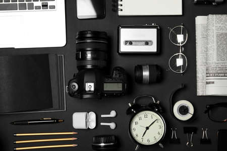 Flat lay composition with equipment for journalist on black background Stock Photo