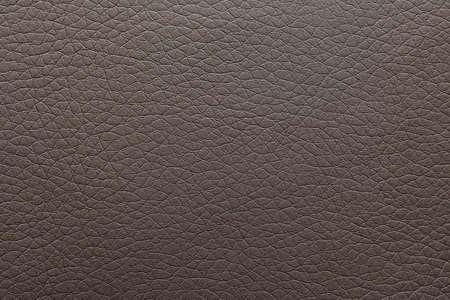 Texture de cuir foncé comme toile de fond, gros plan