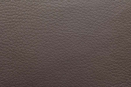 Texture of dark leather as background, closeup