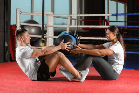 Young couple working out in modern gym
