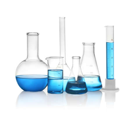 Different laboratory glassware with light blue liquid isolated on white