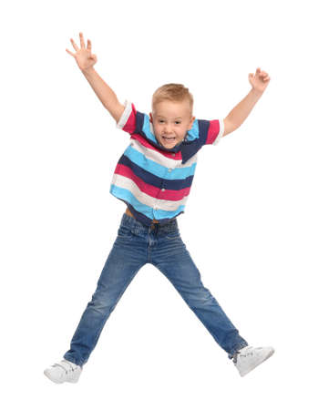 Cute little boy jumping on white background