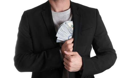 Man putting bribe money into pocket on white background, closeup