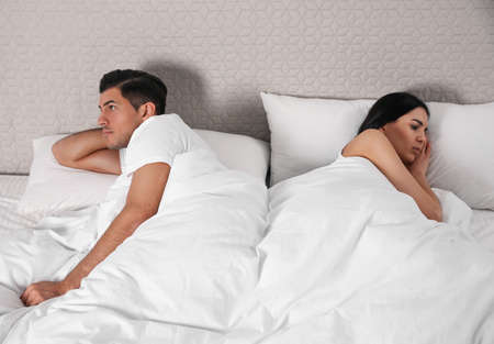 Unhappy couple with relationship problems after quarrel in bed