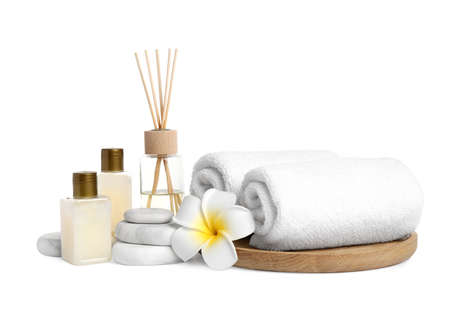 Beautiful spa composition with reed diffuser on white background
