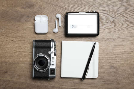 Flat lay composition with equipment for journalist on wooden table Stock Photo