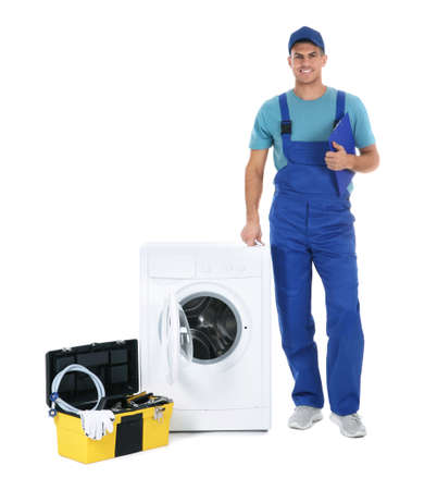 Repairman with clipboard and toolbox near washing machine on white background