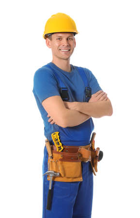 Handsome carpenter with tool belt isolated on white Stockfoto