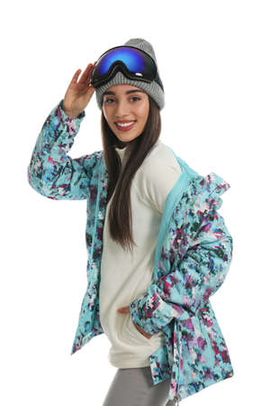 Woman wearing stylish winter sport clothes on white background