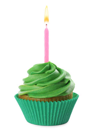 Delicious birthday cupcake with candle and green cream isolated on white