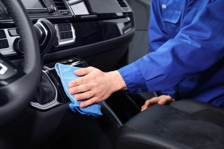 Car wash worker cleaning automobile interior, closeup Stockfoto