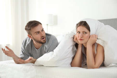 Unhappy young couple quarreling at home. Relationship problems