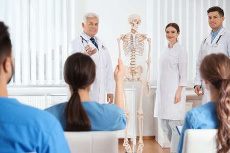 Medical students having lecture in orthopedics at clinic Stock Photo - 140195930