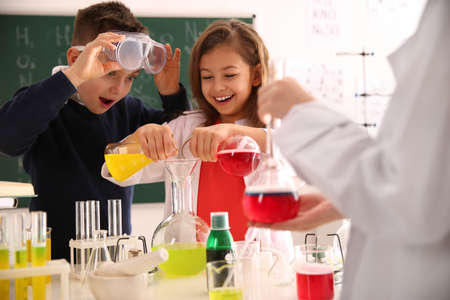 Smart pupils making experiment in chemistry class Stock Photo