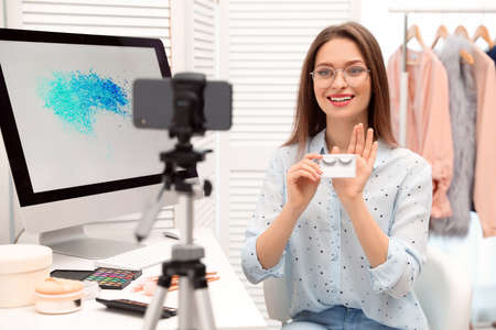 Beauty blogger filming make up tutorial at home