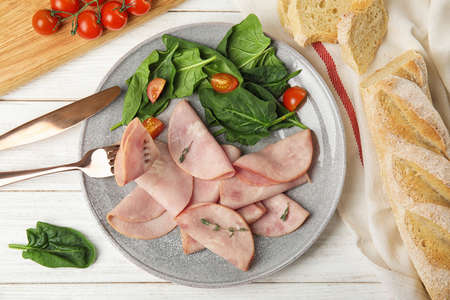 Tasty ham served on white wooden table, flat lay 写真素材