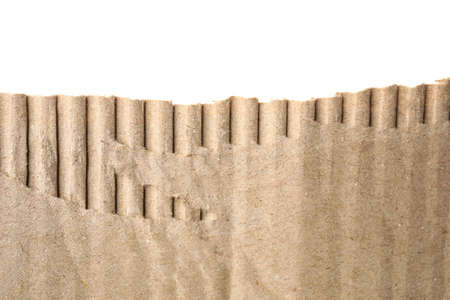 Piece of torn cardboard on white background, closeup