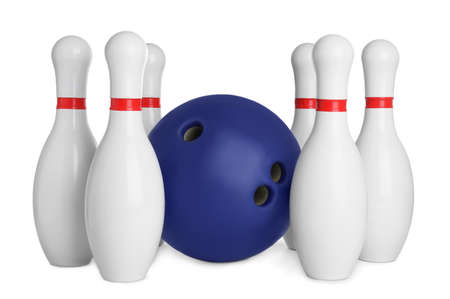 Blue bowling ball and pins isolated on white