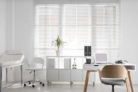 Doctor's office interior with modern workplace in clinic Foto de archivo