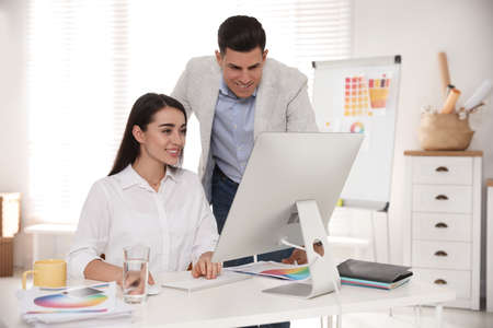 Professional designers working together in modern office