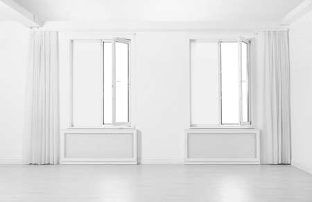 Windows with elegant curtains and blinds in empty room Stockfoto