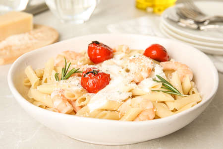 Delicious pasta with shrimps on light grey table 写真素材
