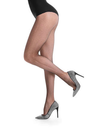 Woman wearing black tights and stylish shoes isolated on white, closeup of legs 免版税图像