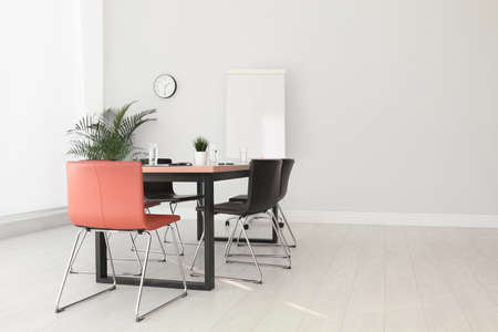 Simple office interior with large table and chairs