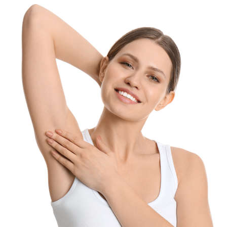 Young beautiful woman showing armpit with smooth clean skin on white background