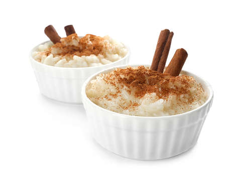 Delicious rice pudding with cinnamon isolated on white