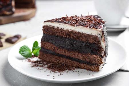 Tasty chocolate cake served on table, closeup