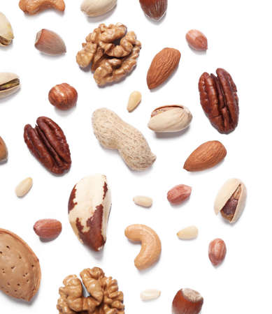 Different delicious nuts on white background, flat lay. Space for text