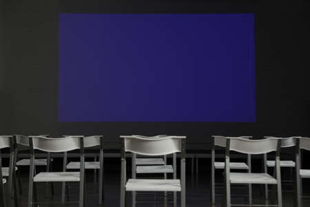 Empty conference room with projection screen and chairs Banco de Imagens