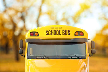 Yellow school bus outdoors. Transport for students Stock Photo
