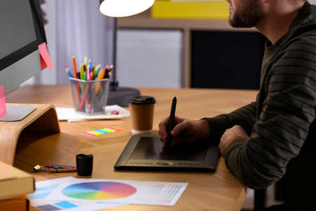 Male designer working at desk in office, closeup Stock fotó