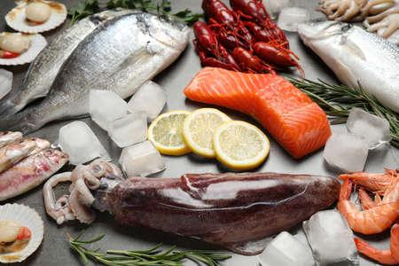 Fresh fish and seafood on grey table