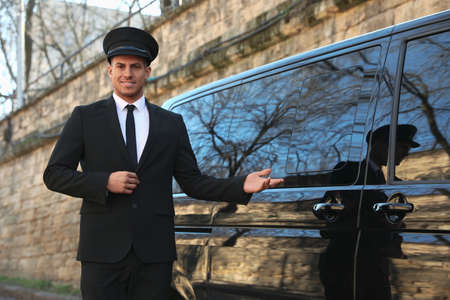 Professional driver near luxury car outdoors. Chauffeur service