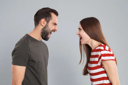 Couple quarreling on grey background. Relationship problems Reklamní fotografie