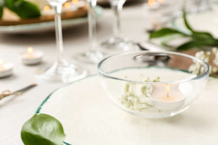 Elegant table setting with green plants, closeup
