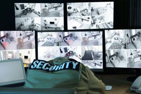 Tired security guard sleeping at workplace in office Banco de Imagens