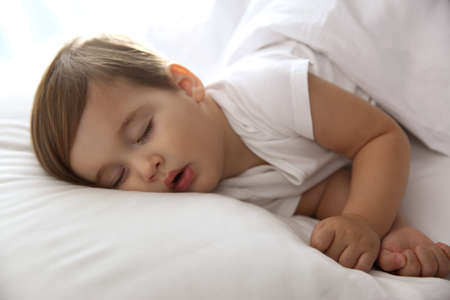 Cute little baby peacefully sleeping at home. Bedtime