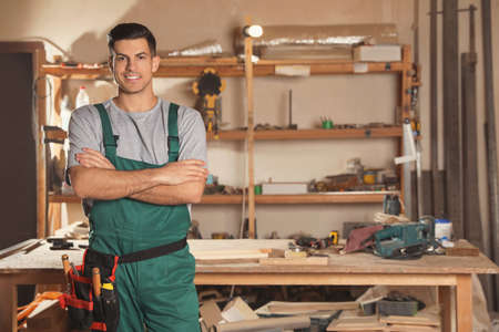 Professional carpenter with set of tools in workshop Stockfoto