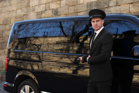 Driver opening door of luxury car. Chauffeur service