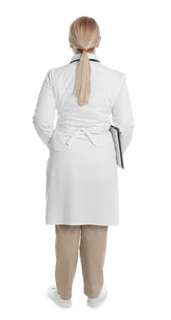 Doctor in clean uniform with clipboard on white background Reklamní fotografie